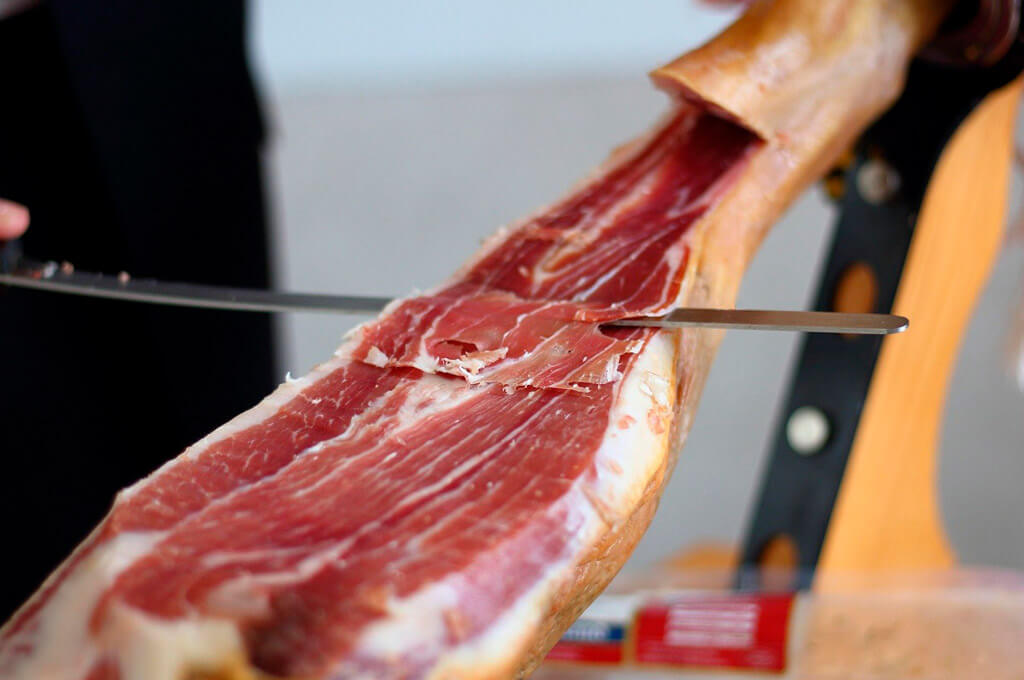 Tasting of freshly cut ham