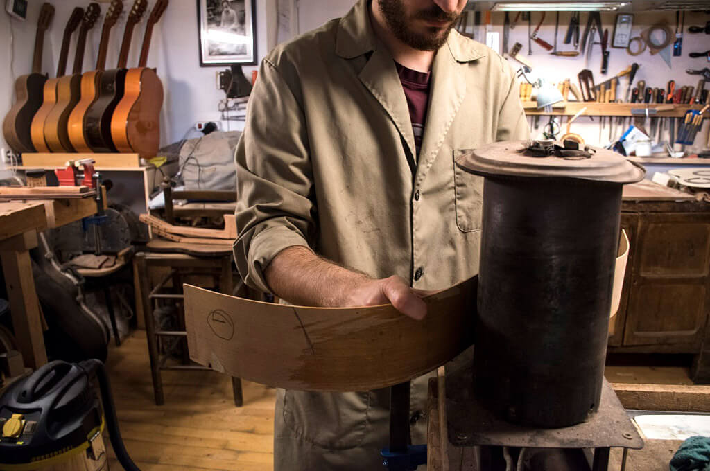 A luthier makes Spanish guitar
